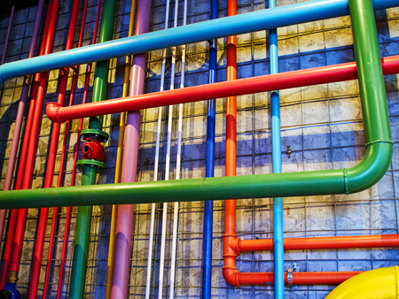 Pipes in bright strong colors great industrial modern background image Standard-Bild