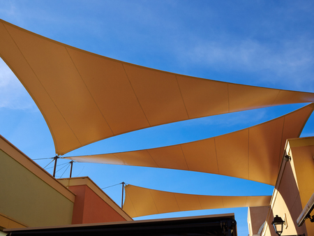 Modern design pergola arbor made with cloth fabric with background of blue summer sky