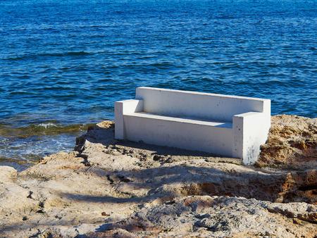 playa blanca: Bench made of stone in beautiful popular summer tourism destination Torrevieja beach, Costa Blanca, Valencia, Spain