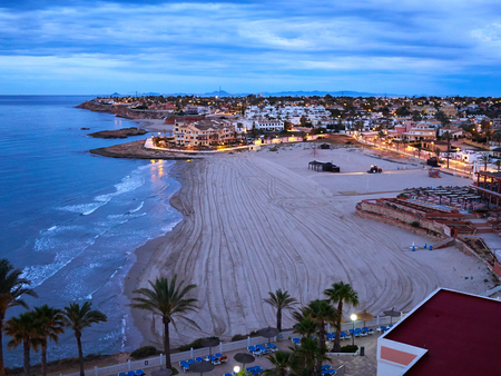 Popular great summer vacation travel destination La Zenia Beach Orihuela Costa South Spain 免版税图像