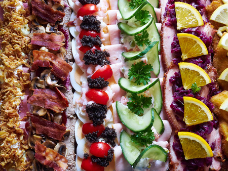Selection of Smoerrebroed Danish open faced sandwiches on a serving plate