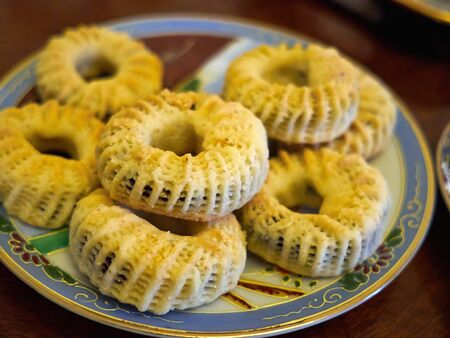 Maamoul (klecha) traditional Arabic Turkish homemade cookies filled with dates served in a beautiful decorative plate