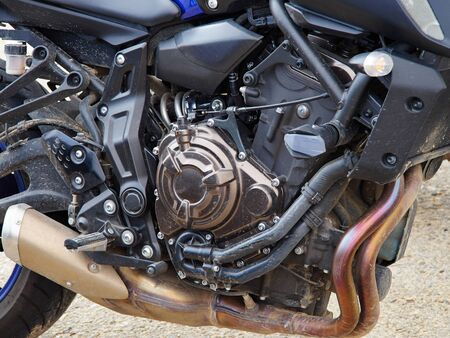 Closeup details of a modern design motorbike motorcycle great extreme sport background image