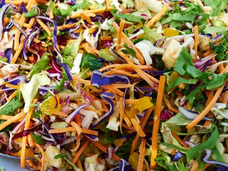 Healthy organic vegetable salad made of fresh lettuce, sliced carrot, cabbage and spice - healh food background Zdjęcie Seryjne