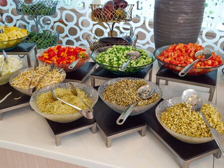 Salad bar with fresh organic vegetables in the restaurant healthy vegan food concept
