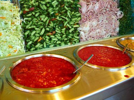 Salad bar with fresh organic vegetables in a street food restaurant typical Mediterranean Middle East cuisine Zdjęcie Seryjne