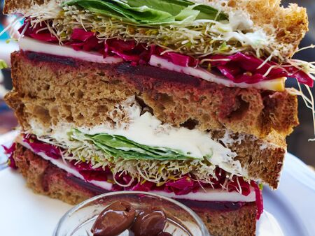 Healthy fresh sandwich of dark whole wheat bread with slices of cheese and variety of organic vegetables Zdjęcie Seryjne