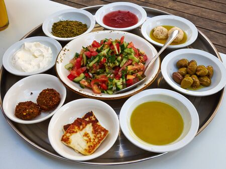 Arab Middle East Mediterranean Meze style breafast with salad, falafel, olives, Zaatar and cheese Stok Fotoğraf