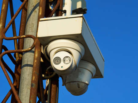 Security surveillance camera on a metal pole Big Brother is watching 写真素材