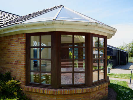 Beautiful cozy sunny solarium conservatory sun room great extention of a house Stockfoto