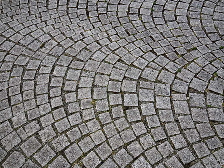 Traditional old calssic design cobbled stones road in a pattern Denmark