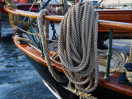 Old traditional wooden sailing boat sails and rigging on sea - sailing yachting background image Banque d'images