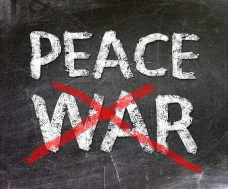 Peace and war written on a chalkboard                        Stock Photo