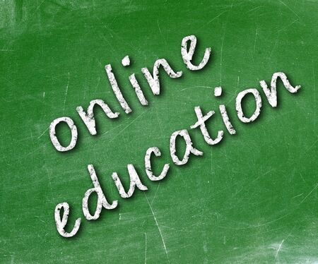 Online education school written on a chalkboard                    photo