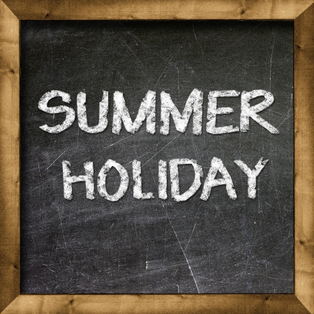 Summer Holiday handwritten with white chalk on a blackboard  Stock Photo - 19094811
