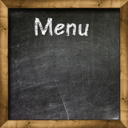 Menu title written with chalk on blackboard Stock Photo