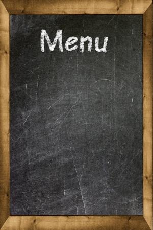 Menu title written with chalk on blackboard photo