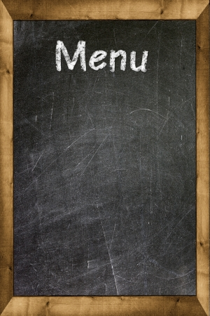 Menu title written with chalk on blackboard Stock Photo