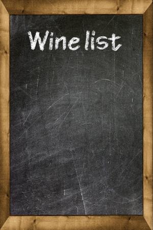 Wine list written with white chalk on a blackboard