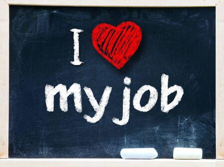 I love my job handwritten with white chalk on a blackboard Stock Photo - 25555488