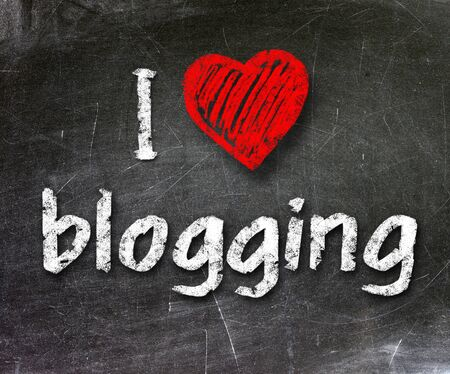 I love my blog handwritten with white chalk on a blackboard                    photo