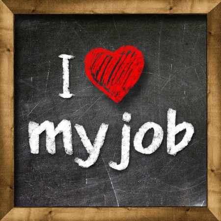 I love my job handwritten with white chalk on a blackboard