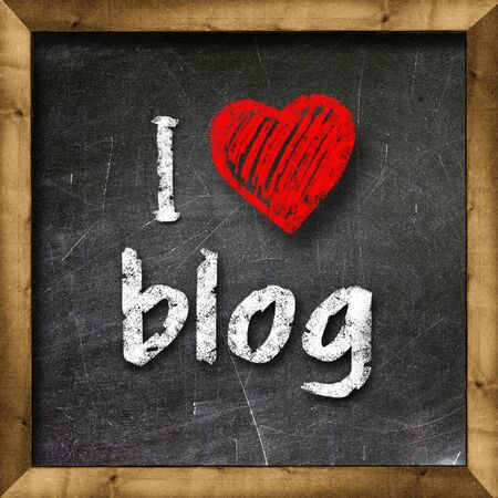 I love my blog handwritten with white chalk on a blackboard Stock Photo