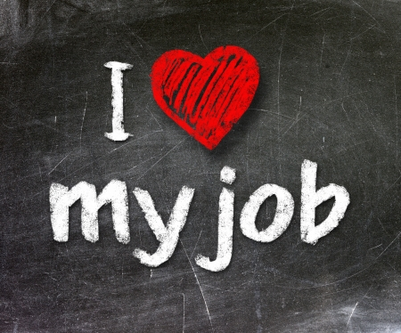 I love my job handwritten with white chalk on a blackboard                       Stock Photo - 20601531
