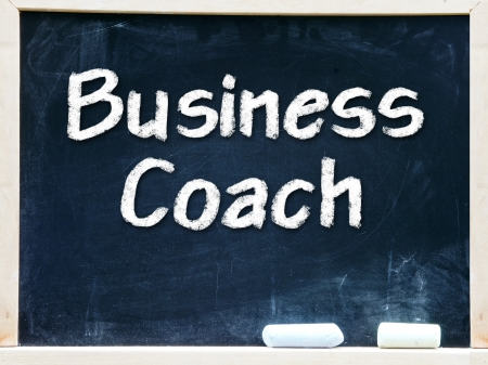 Business Coach handwritten with white chalk on a blackboard                      photo