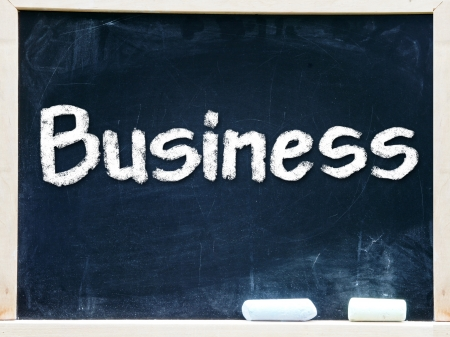 Business handwritten with white chalk on a blackboard          photo