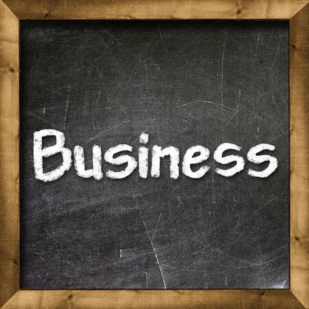 Business handwritten with white chalk on a blackboard Stock Photo