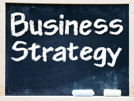 Business Strategy handwritten with white chalk on a blackboard