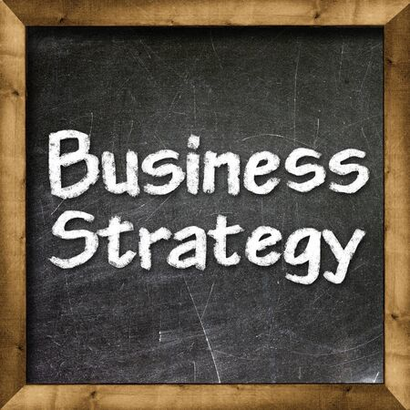 Business Strategy handwritten with white chalk on a blackboard photo