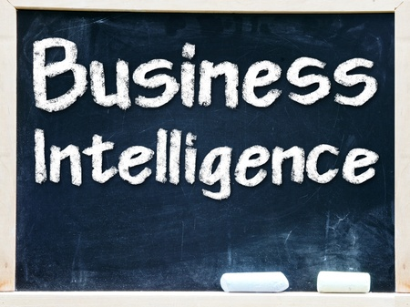 Business Intelligence handwritten with white chalk on a blackboard                      photo