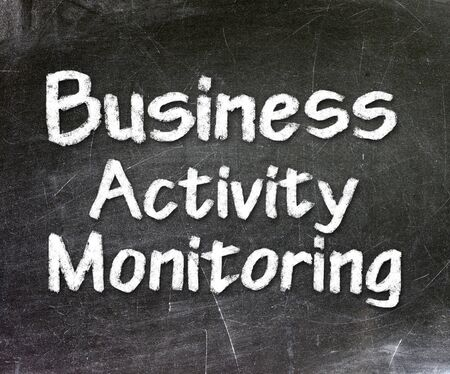 Business Activity Monitoring Intelligence handwritten with white chalk on a blackboard                     photo