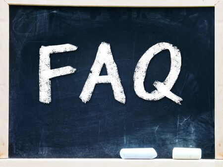 FAQ handwritten with white chalk on a blackboard                   photo