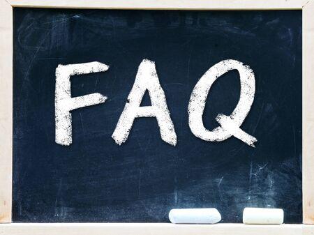 FAQ handwritten with white chalk on a blackboard Stock Photo - 20601432