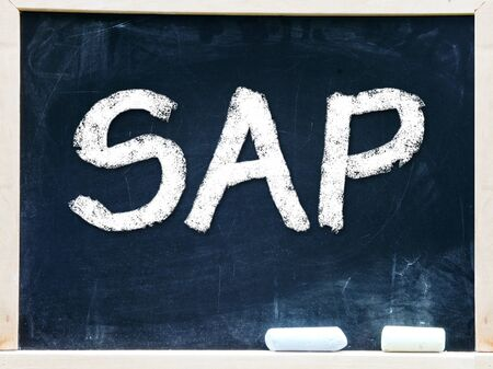 SAP handwritten with white chalk on a blackboard                     photo