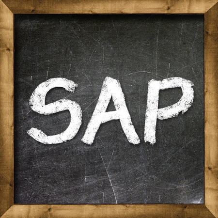 sap: SAP handwritten with white chalk on a blackboard