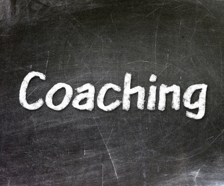 Coaching handwritten with white chalk on a blackboard                        photo