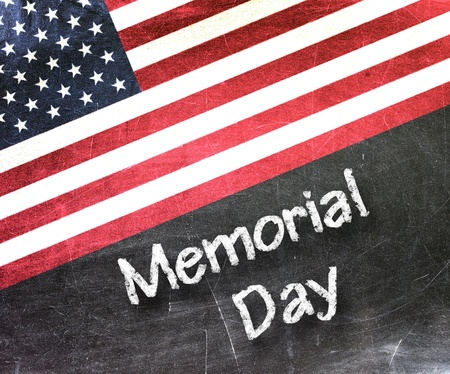 Memorial day handwritten with white chalk on a blackboard                       Stock Photo