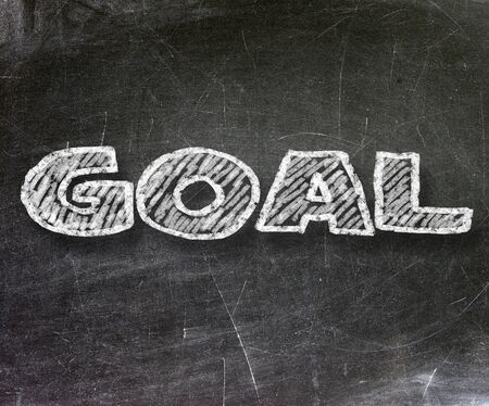 Goal handwritten with white chalk on a blackboard                   photo