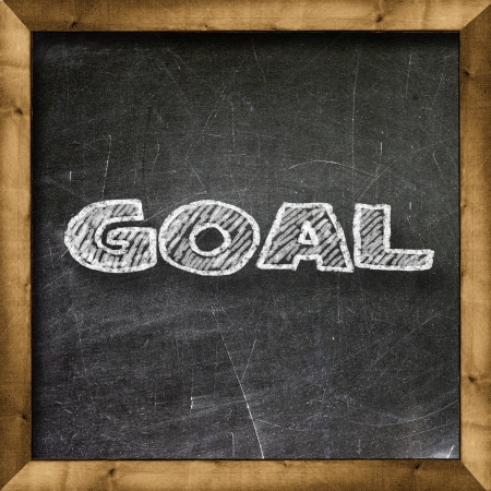 Goal handwritten with white chalk on a blackboard Stock Photo - 20601512