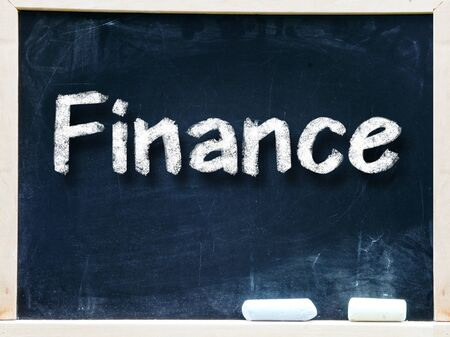 Finance handwritten with white chalk on a blackboard
