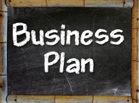 Business Plan handwritten with white chalk on a blackboard