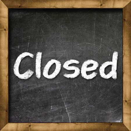 Closed handwritten with white chalk on a blackboard photo