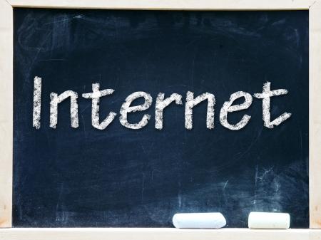 Internet handwritten with white chalk on a blackboard Stock Photo - 20601472