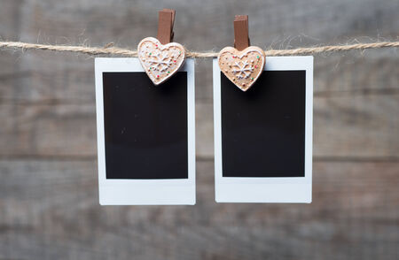 Old blank photo with a heart pinned to the string