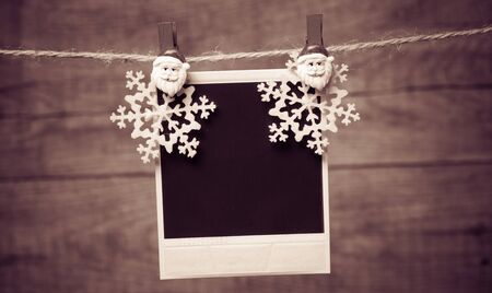 Old pictures on wood background with Christmas decoration