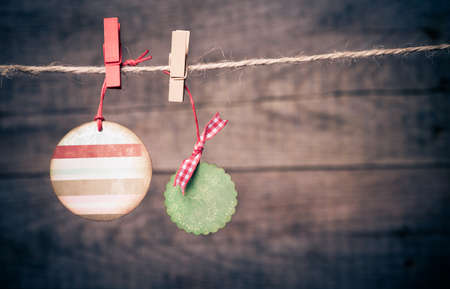 Set of Christmas tags on rope Stock Photo